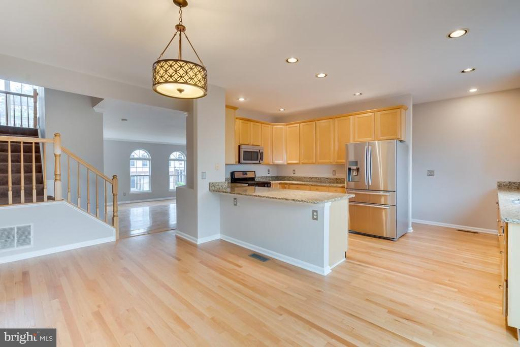View from Dining Area of Kitchen and Family Room! - 5266 BALLYCASTLE CIR, ALEXANDRIA