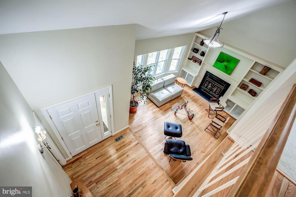 View of living room & entry foyer from upper level - 11012 BURYWOOD LN, RESTON
