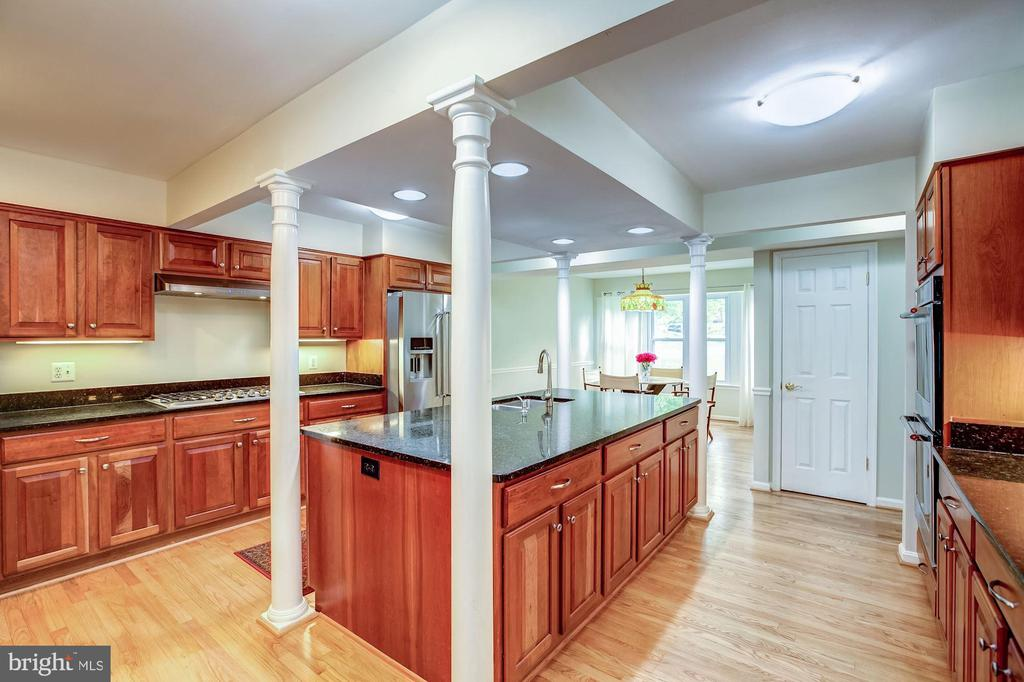 Kitchen with ample cabinetry & hardwood floors - 11012 BURYWOOD LN, RESTON
