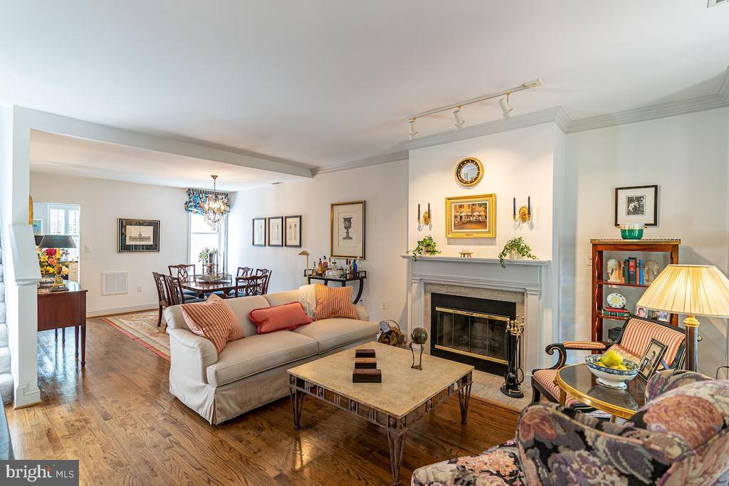 Living room with fireplace & wood floors - 1426 SWANN ST NW, WASHINGTON