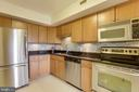 Under cabinet lighting.  Built in microwave. - 2230 GEORGE C MARSHALL DR #827, FALLS CHURCH