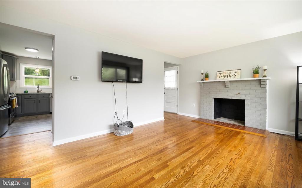 Living room off of kitchen - nice hardwoods - 5239 REELS MILL RD, FREDERICK
