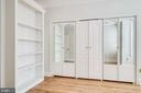 Built-in shelving and closets in master bedroom. - 116 S PITT ST, ALEXANDRIA