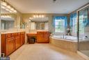master bath with his/hers vanity - 147 SANFORD FERRY CT, FREDERICKSBURG