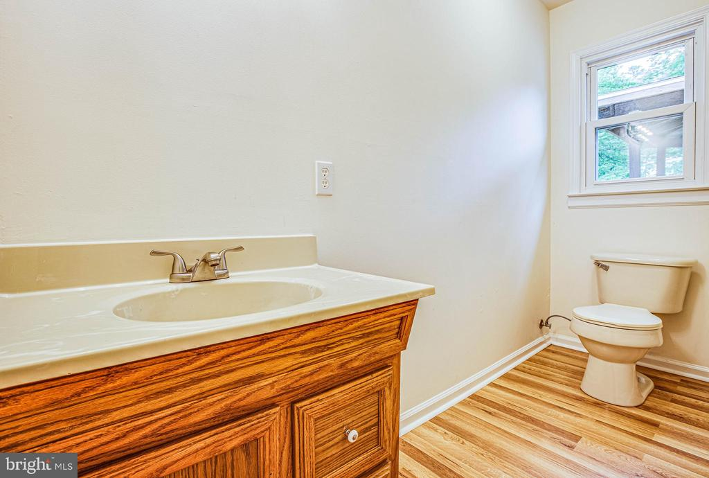 Down the hall pass by the full bath with new floor - 10905 DEERFIELD DR, FREDERICKSBURG