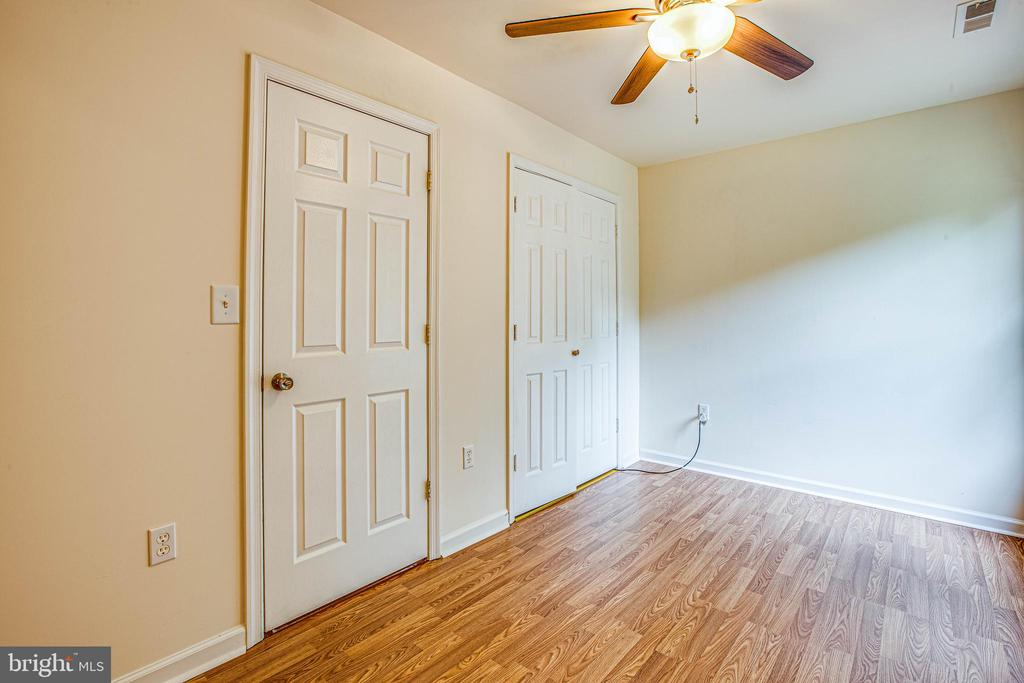 New flooring and ceiling fan in bedroom 2 - 10905 DEERFIELD DR, FREDERICKSBURG