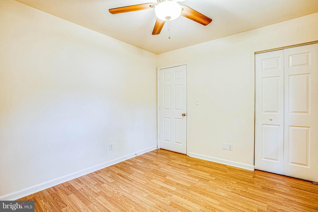 Bedroom 5 has new flooring and ceiling fan - 10905 DEERFIELD DR, FREDERICKSBURG