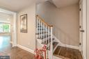 Stairs lead to the upper level with 5 bedrooms! - 5000 27TH ST N, ARLINGTON