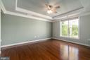 Main level master bedroom with lots of light - 20441 ISLAND WEST SQ, ASHBURN