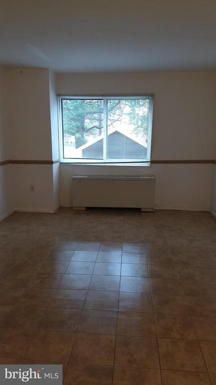 View of living room from entry foyer. - 4313 KNOX RD #209, COLLEGE PARK