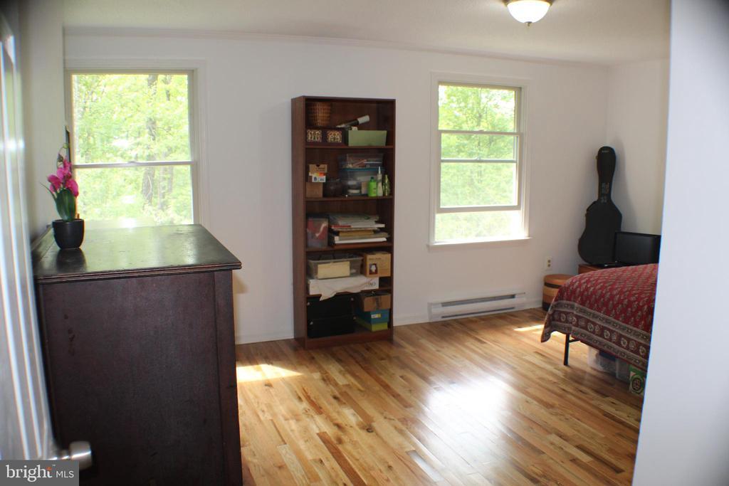 Bedroom 2 with new hardwood floors - 7738 TALBOT RUN RD, MOUNT AIRY
