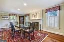 Dining room with woodburning fireplace - 1002 MOSS HAVEN CT, ANNAPOLIS