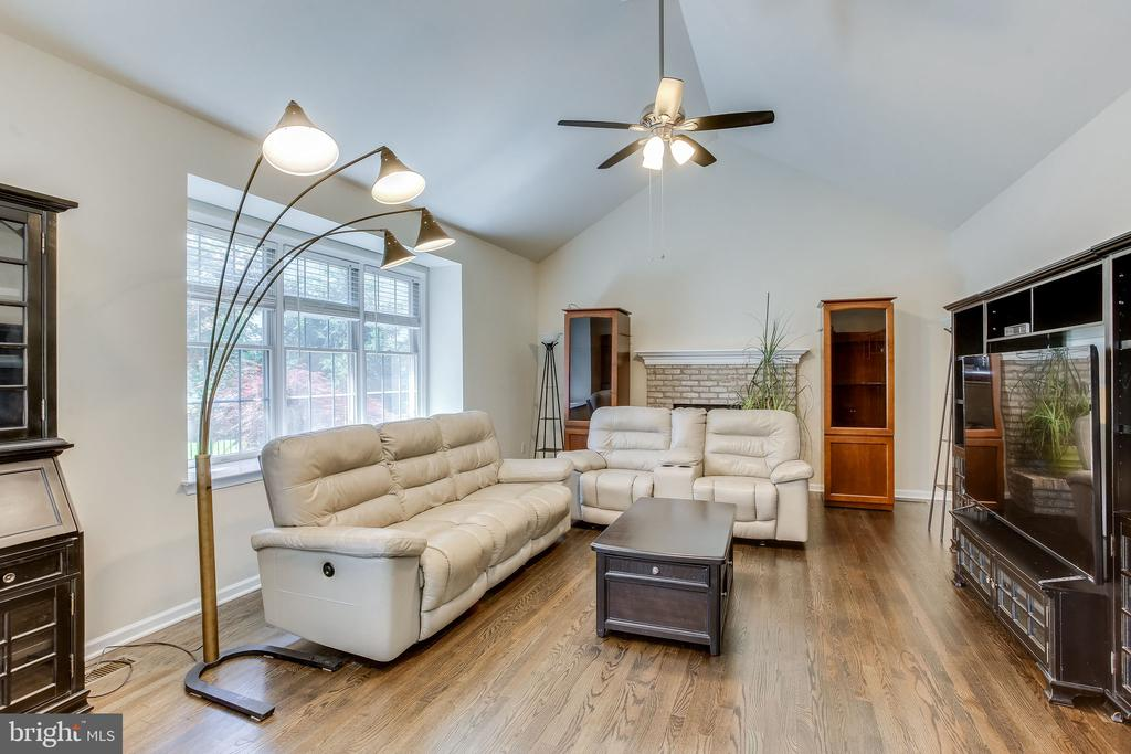 Family room with wood burning fireplace - 22766 OATLANDS GROVE PL, ASHBURN