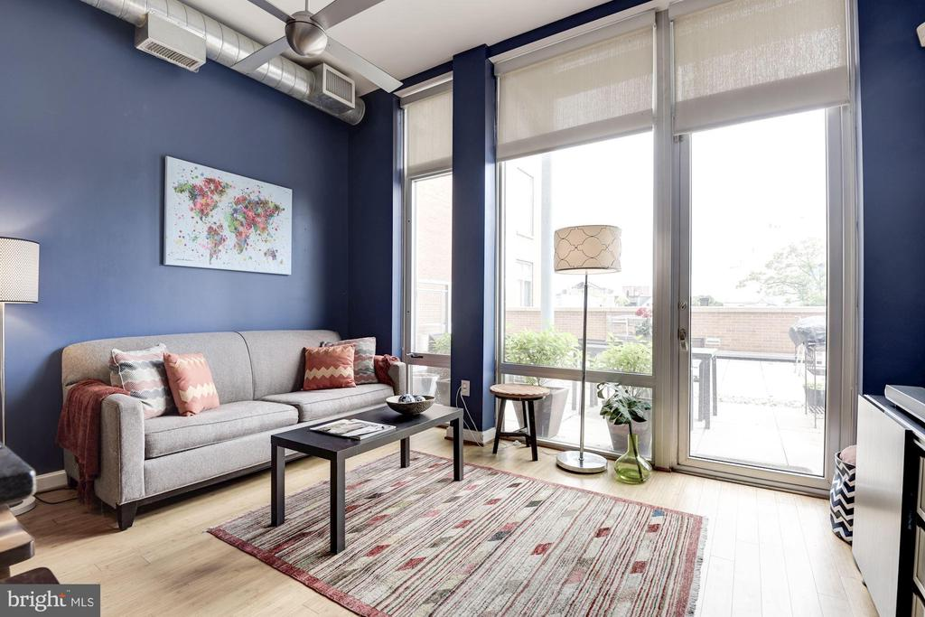 Living room with bamboo floors and... - 1390 V ST NW #209, WASHINGTON
