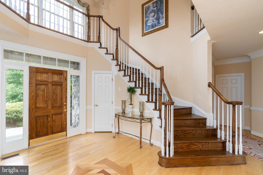 Two-story foyer and front staircase - 3242 FOXVALE DR, OAKTON