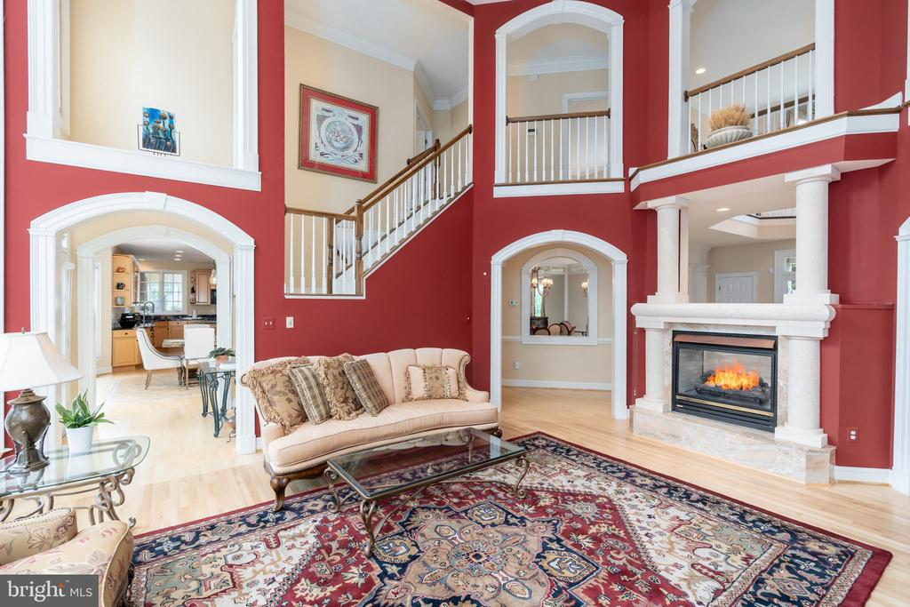 Two-story family room with gas fireplace - 3242 FOXVALE DR, OAKTON