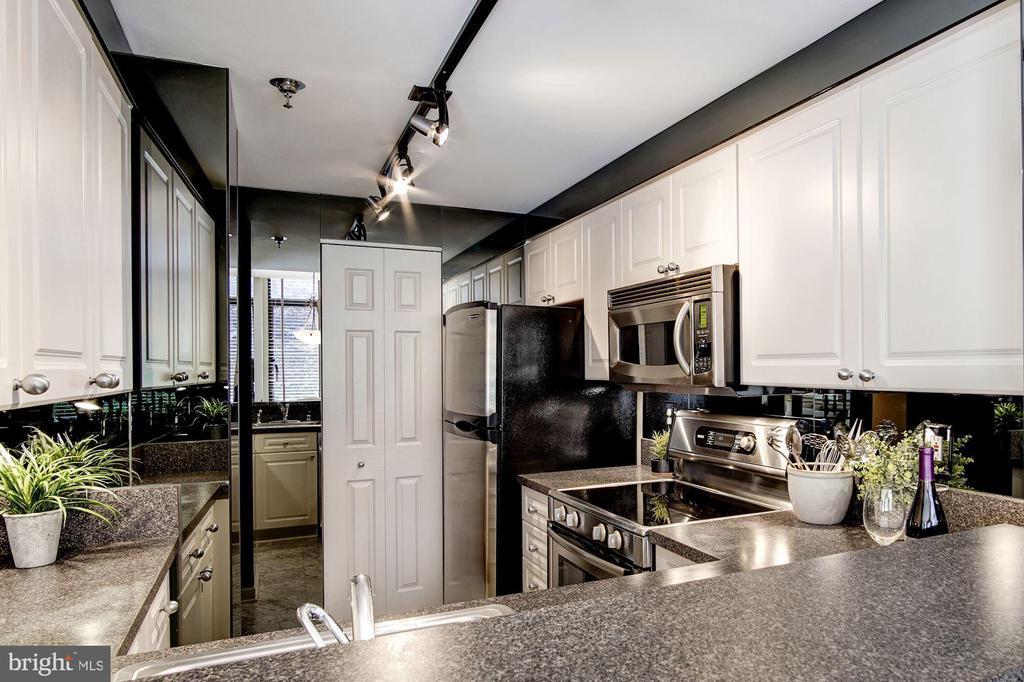Kitchen with large pantry and breakfast bar. - 1312 MASSACHUSETTS AVE NW #109, WASHINGTON