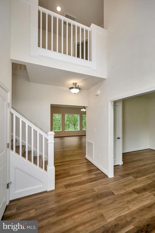 Two story foyer with beautiful hardwood floors - 34129 ENCHANTED WAY, LOCUST GROVE