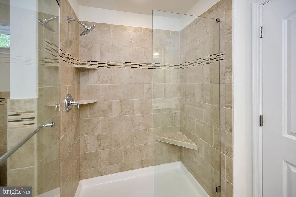 Shower with detailed tile work and glass door - 34129 ENCHANTED WAY, LOCUST GROVE