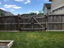 Privacy Fence with double gates - 112 FREESIA LN, STAFFORD