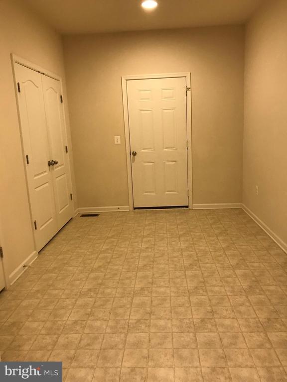 Mud Room leading to Garage, 14' x 11' - 112 FREESIA LN, STAFFORD