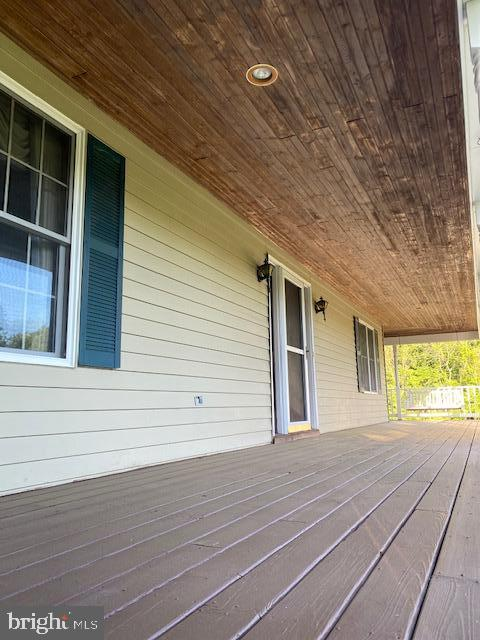 Huge front porch with that porch swing! - 7185 REBEL DR, WARRENTON