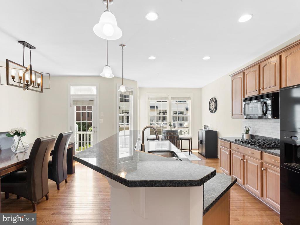 Open Kitchen with Bump Out and Balcony Access - 8903 AMELUNG ST, FREDERICK
