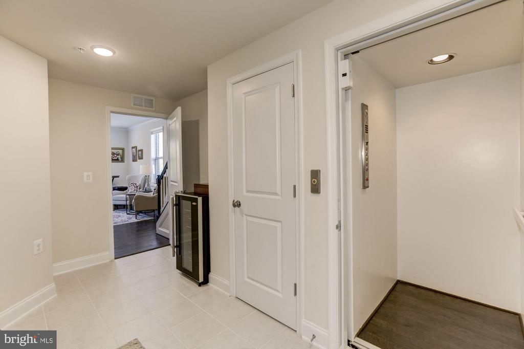 Private elevator right inside from garage. - 42890 SANDY QUAIL TER, ASHBURN