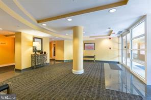 Main lobby enclosed by full glass windows - 301 S REYNOLDS ST #601, ALEXANDRIA