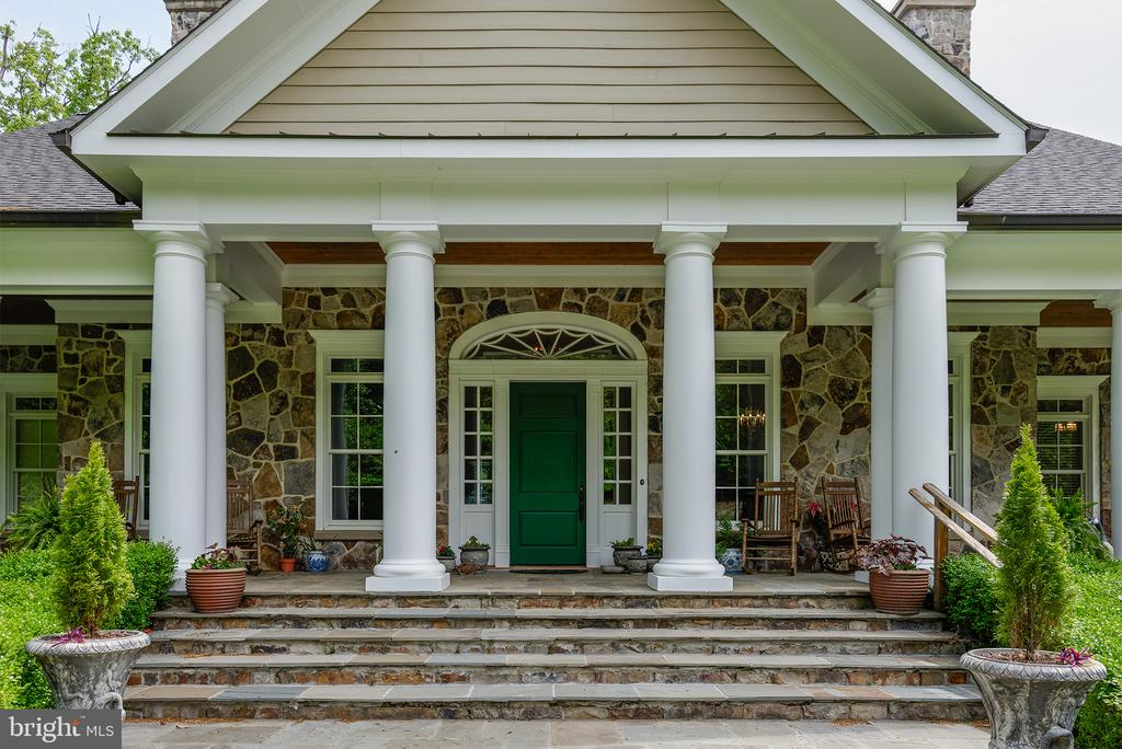 A large slate stone Southern Style front porch - 41430 FOX CREEK LN, LEESBURG