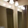Half bath vanity lighting and medicine cabinet - 301 S REYNOLDS ST #601, ALEXANDRIA