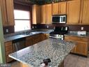 Updated kitchen with moveable island - 4830 OLD HOLTER RD, JEFFERSON