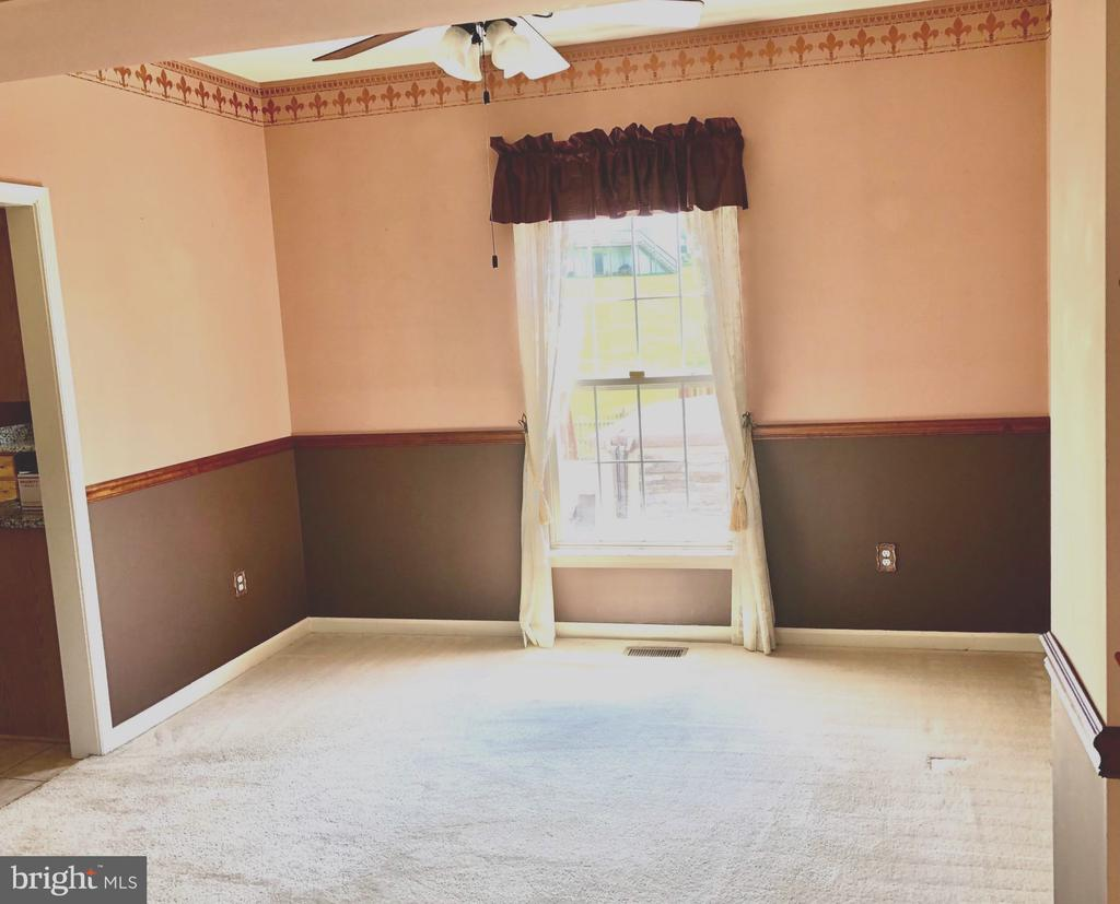 Dining room and living room with plenty of natural - 4830 OLD HOLTER RD, JEFFERSON