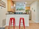 Kitchen with breakfast bar - 3350 17TH ST NW #T2, WASHINGTON