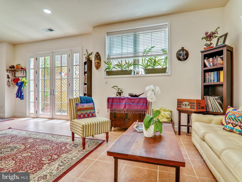 Living room with french doors to patio - 3350 17TH ST NW #T2, WASHINGTON