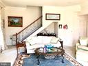 Family Room with secondary stairs to upper level. - 14414 BROADWINGED DR, GAINESVILLE