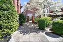 Walkway and gated entrance to side courtyard - 712 E CAPITOL ST NE, WASHINGTON