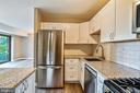 Comfortable modern kitchen. - 7358 LEE HWY #T1, FALLS CHURCH