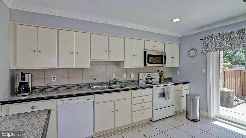 Main kitchen with painted cabinets and custom appl - 11210 LAGOON LN, RESTON
