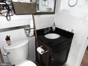 Bathroom with granite sink. - 2504 22ND ST NE #6, WASHINGTON