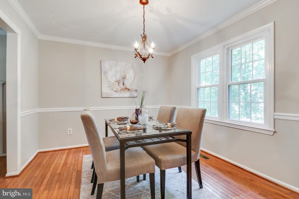Formal dining room with chair and crown molding - 14422 WILLIAM CARR LN, CENTREVILLE