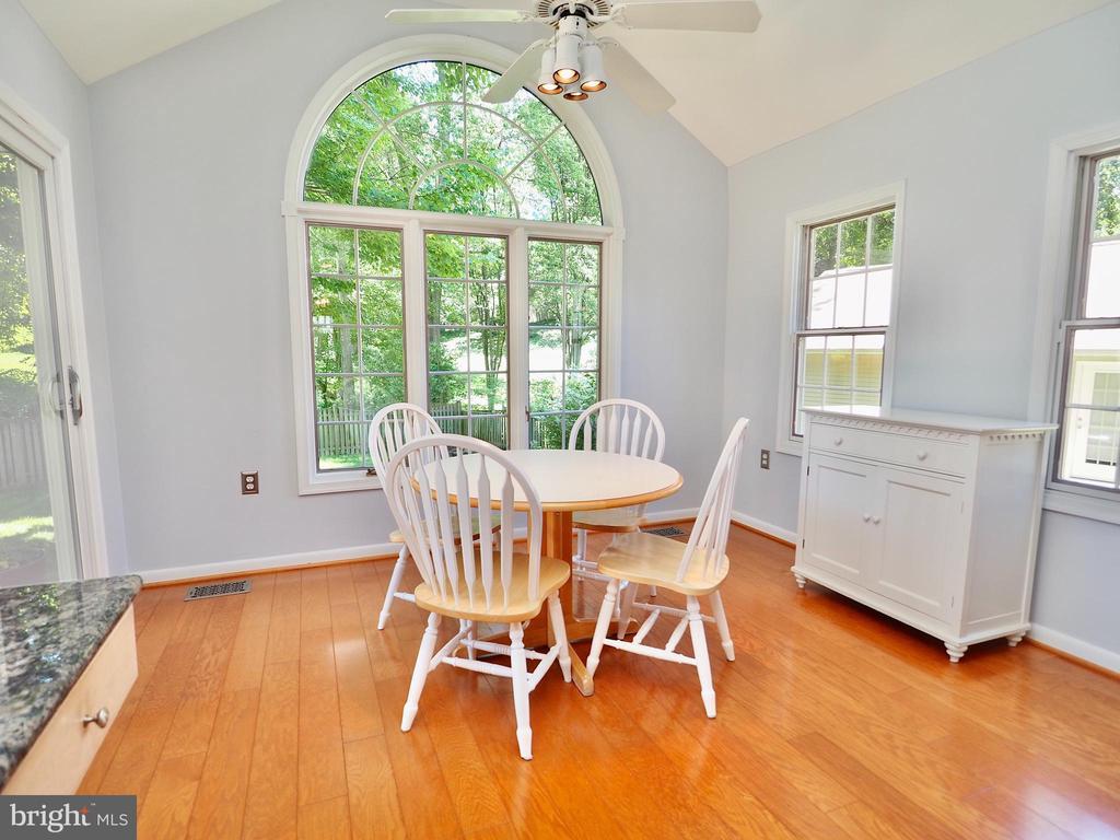 Imagine enjoying your mornings in this sunroom - 6218 GENTLE LN, ALEXANDRIA