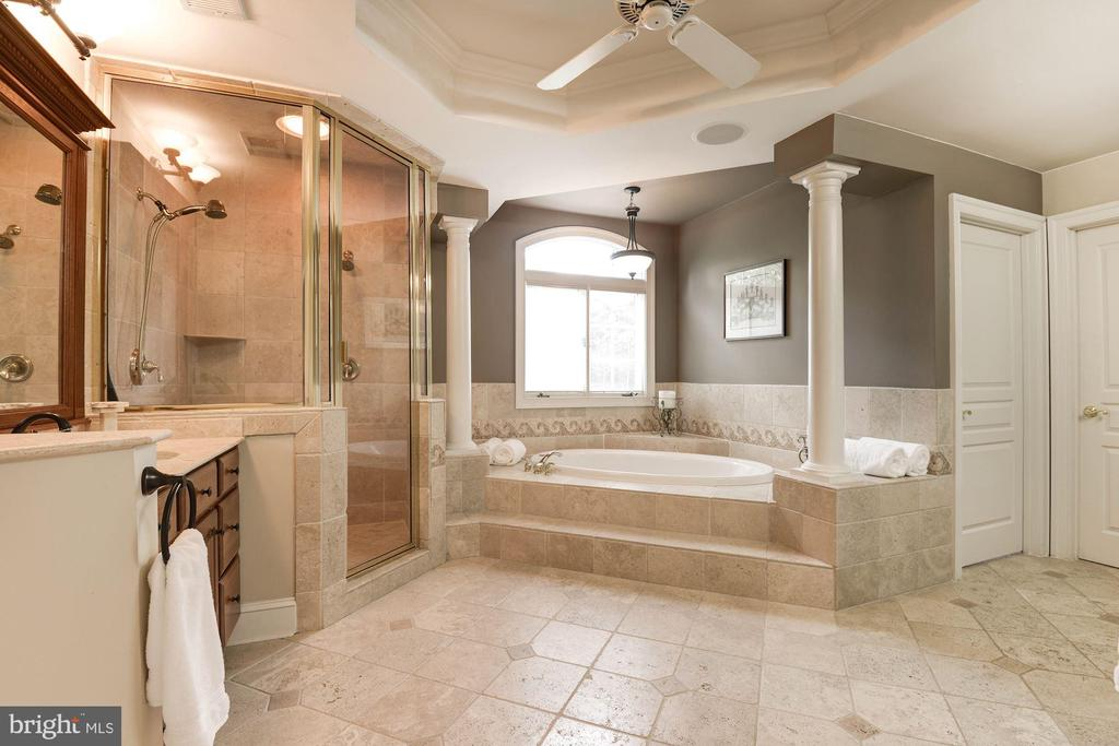 Master bath with beautiful travertine flooring... - 11594 CEDAR CHASE RD, HERNDON