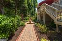 Lower level extensive landscaping &fountain.. - 11594 CEDAR CHASE RD, HERNDON