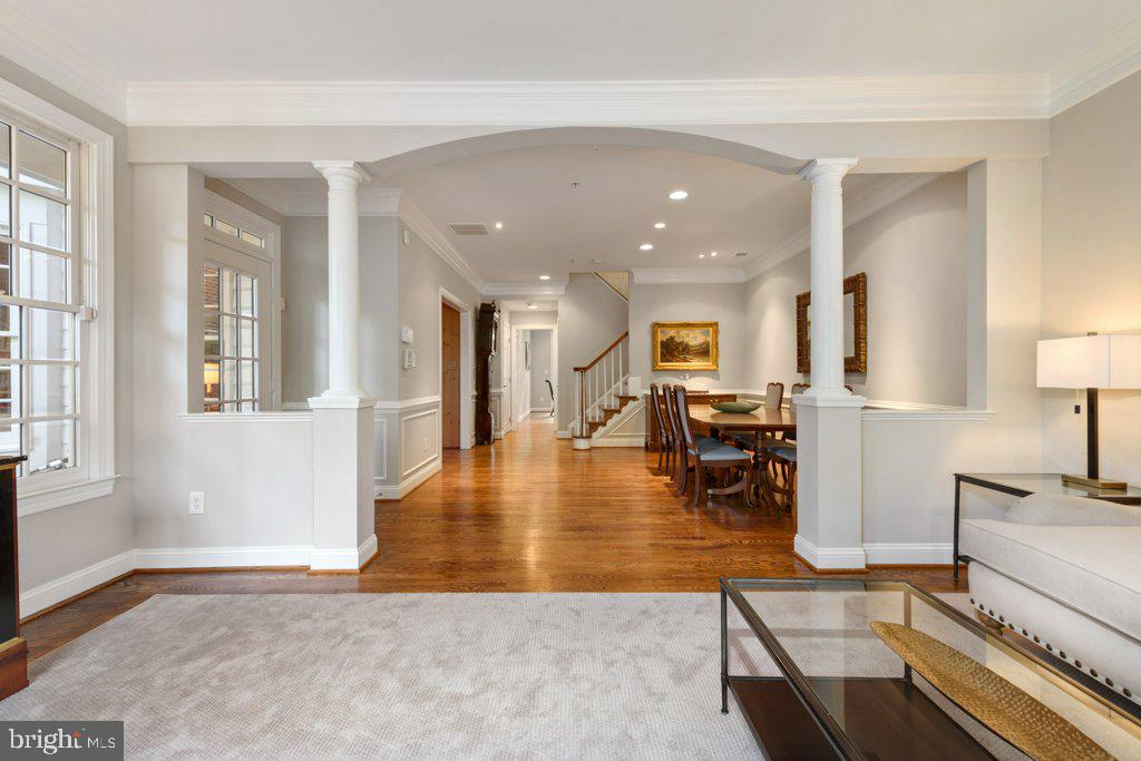 Pass through the arch to the expansive dining room - 405 S HENRY ST, ALEXANDRIA