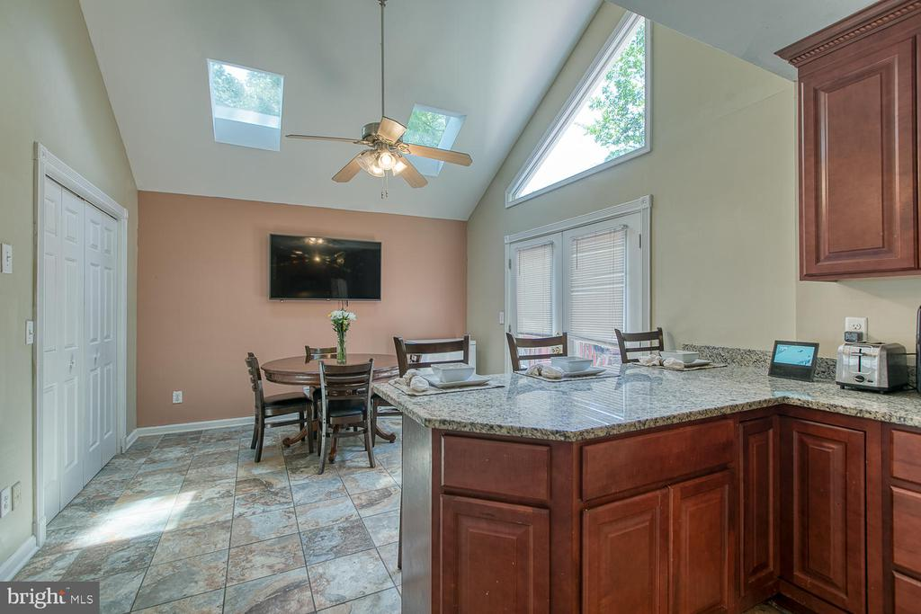 Spacious Kitchen dining area with skylights - 11018 ABBEY LN, FREDERICKSBURG