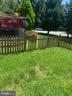 Fenced yard - 4111 SWISS STONE DR, BURTONSVILLE
