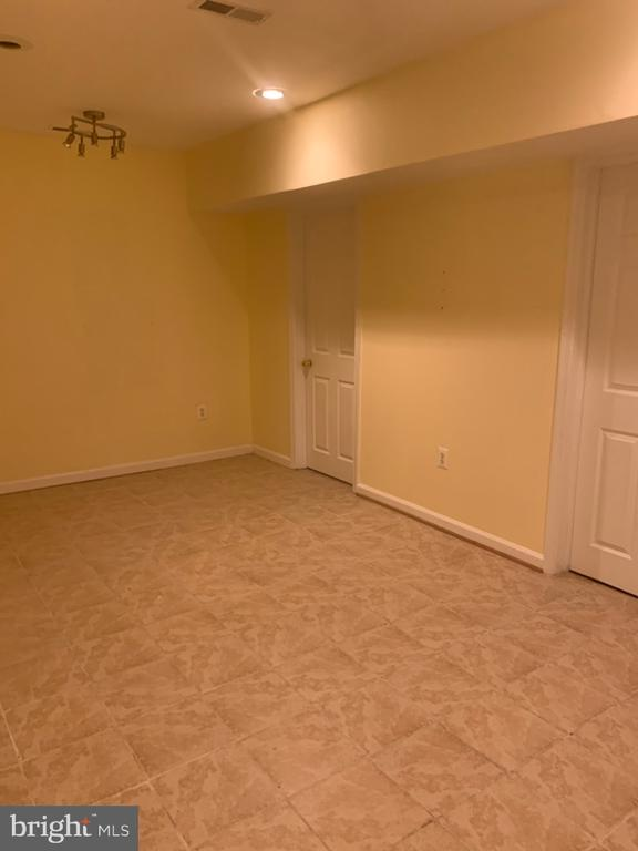 Finished rec room in basement - 4111 SWISS STONE DR, BURTONSVILLE