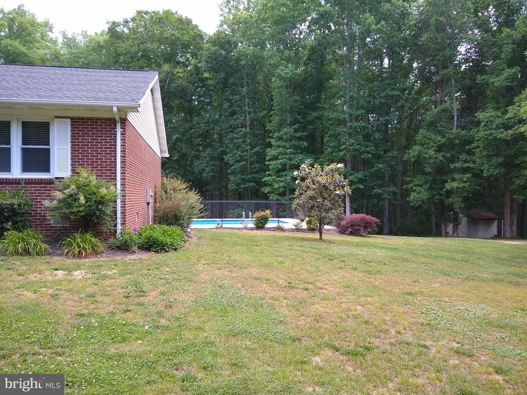 Side view with  magolia tree - 22191 BERRY RUN RD, ORANGE