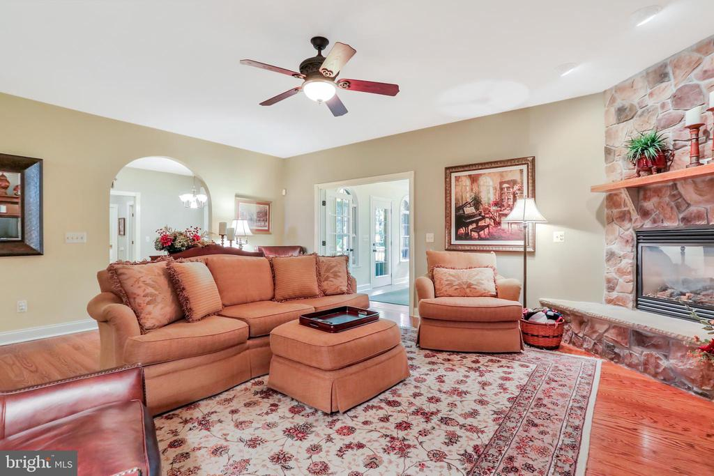 Living room featuring a gas fireplace - 92 EARLE RD, CHARLES TOWN
